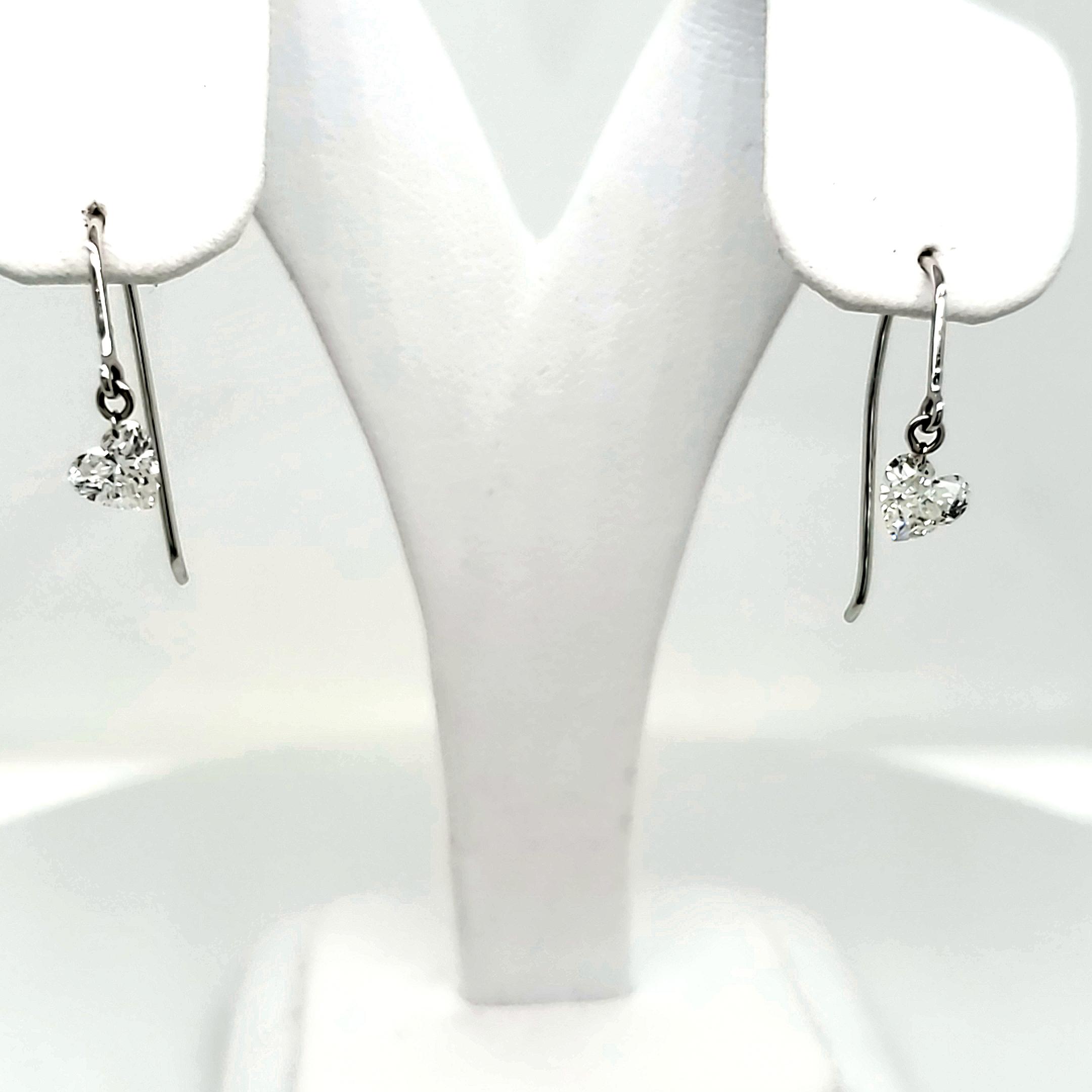 .95 tcw. Diamond Heart Earrings